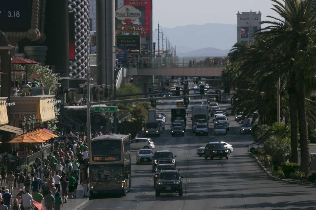 Crowds of pedestrians are seen bordering Las Vegas Boulevard South near Paris Las Vegas hotel-casino on the Las Vegas Strip on Friday, March 17, 2017, in Las Vegas. (Bridget Bennett/Las Vegas Revi ...