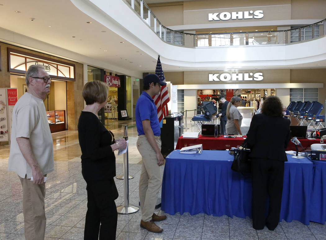 Henderson Residents stand in line before early election day voting for the Clark County municipal election at the Galleria at Sunset mall on Saturday, March 18, 2017, in Las Vegas. (Christian K. L ...