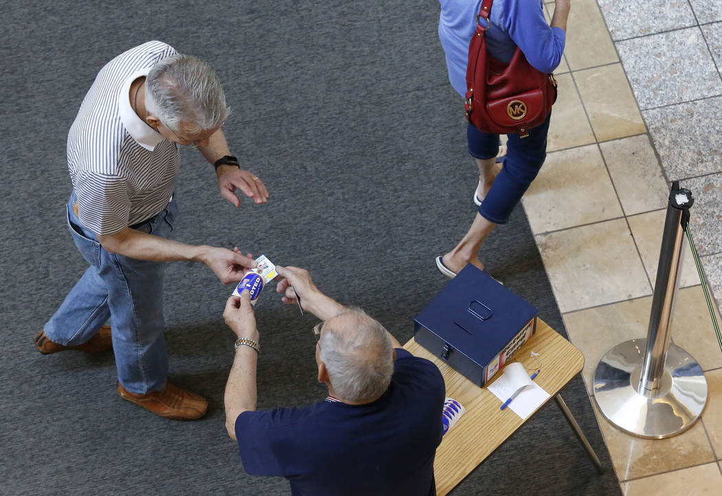 Henderson Residents turn in their ballots after early election day voting for the Clark County municipal election at the Galleria at Sunset mall on Saturday, March 18, 2017, in Las Vegas. (Christi ...