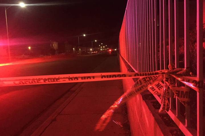 Las Vegas police investigate a shooting on the 6900 block of Issac Drive, near Lake Mead and Ho ...