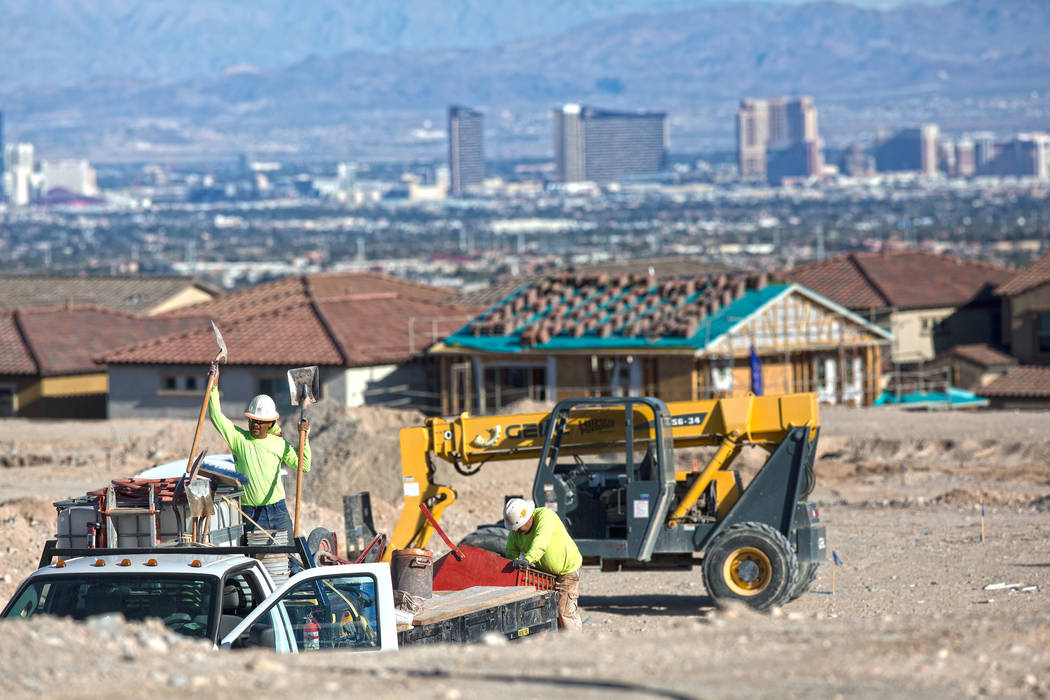 Construction workers prep the area south of The Paseos in Summerlin on Tuesday, Feb. 28, 2017, in Las Vegas. (Benjamin Hager/Las Vegas Review-Journal) @benjaminhphoto