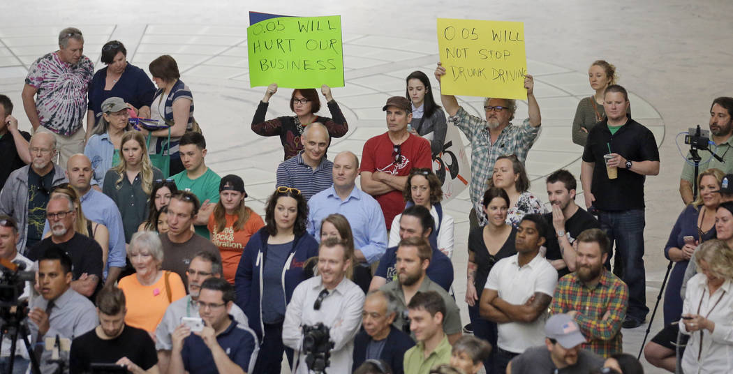Protesters look on during rally at the Utah State Capitol Friday, March 17, 2017, in Salt Lake City. Utah's hospitality industry is urging Gov. Gary Herbert to veto a bill giving Utah the strictes ...