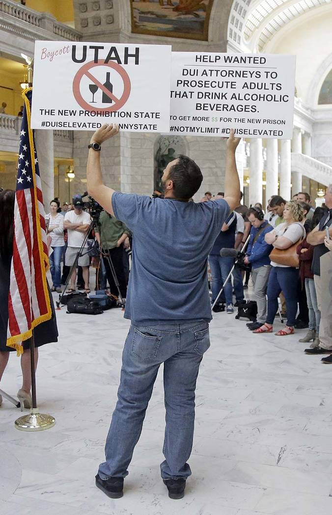 Jerry Fletcher holds a sign during rally at the Utah State Capitol Friday, March 17, 2017, in Salt Lake City. Utah's hospitality industry is urging Gov. Gary Herbert to veto a bill giving Utah the ...