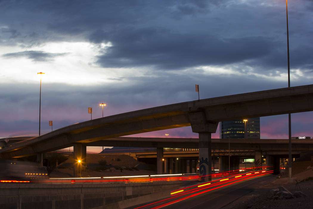 """Traffic flows looking east in this long exposure photograph during the first morning of the """"Big Squeeze"""" along U.S. Highway 95 at the Spaghetti Bowl in Las Vegas on Tuesday, March 21, 2017. (Chas ..."""