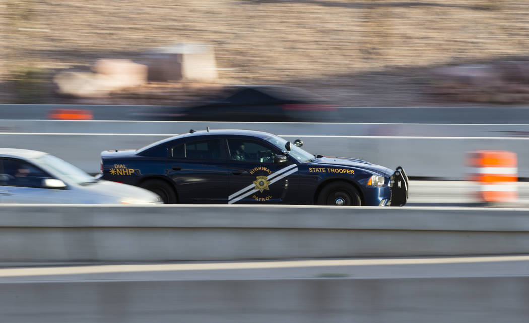 """A Nevada Highway Patrol trooper moves along U.S. Highway 95 during the first morning of the """"Big Squeeze"""" at the Spaghetti Bowl in Las Vegas on Tuesday, March 21, 2017. (Chase St ..."""