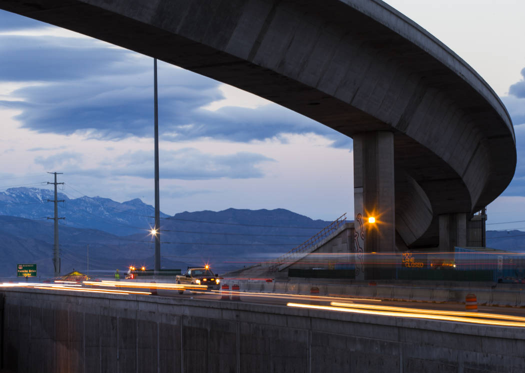 """Traffic flows looking west in this long exposure photograph during the first morning of the """"Big Squeeze"""" along U.S. Highway 95 at the Spaghetti Bowl in Las Vegas on Tuesday, Mar ..."""