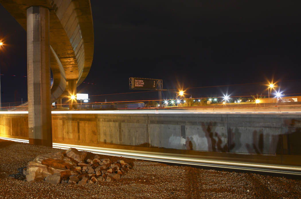 """Traffic moves along U.S. Highway 95 in this long exposure photograph during the first morning of the """"Big Squeeze"""" at the Spaghetti Bowl in Las Vegas on Tuesday, March 21, 2017.  ..."""