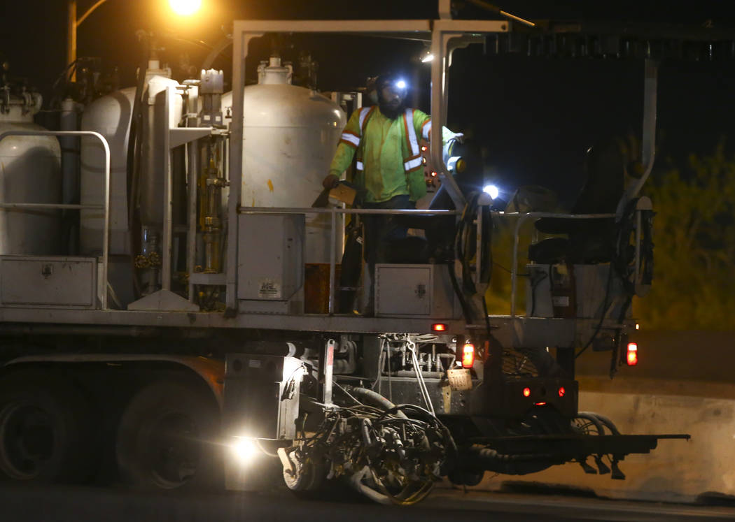 """Highway workers move along U.S. Highway 95 during the first morning of the """"Big Squeeze"""" at the Spaghetti Bowl in Las Vegas on Tuesday, March 21, 2017. (Chase Stevens/Las Vegas R ..."""