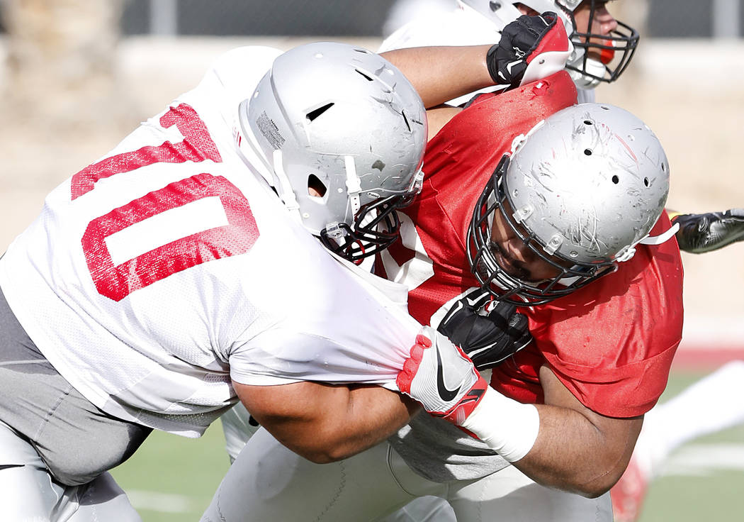 UNLV Rebels defensive line Jason Fao, right, defends offensive line Sid Acosta (70) during team's practice on Monday, March 20, 2017, in Las Vegas. (Bizuayehu Tesfaye/Las Vegas Review-Journal) @bi ...