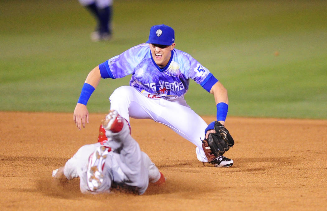 Las Vegas 51s shortstop Gavin Cecchini tags out Memphis Redbirds batter Tommy Pham at second base after Pham tried to stretch a single into a double in the sixth inning of their minor league baseb ...
