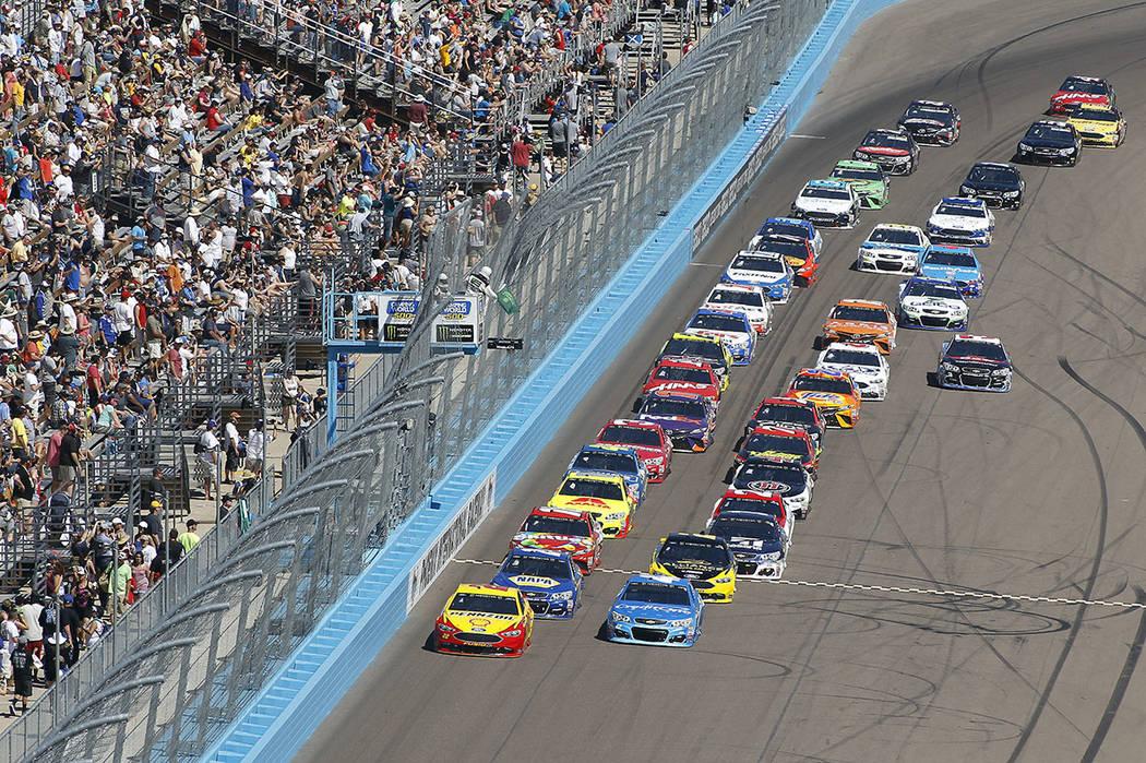 Newman Skips Late Pit Stop Captures Phoenix Race Las