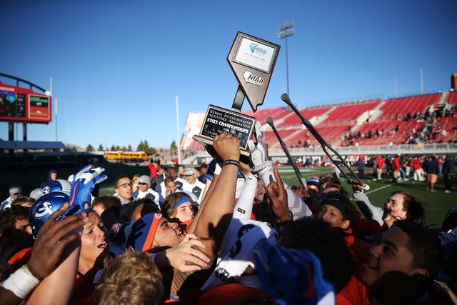 Bishop Gorman celebrates its against Liberty in the Class 4A state football championship game at Sam Boyd Stadium on Saturday, Dec. 3, 2016, in Las Vegas. Bishop Gorman won 84-8. Erik Verduzco/Las ...
