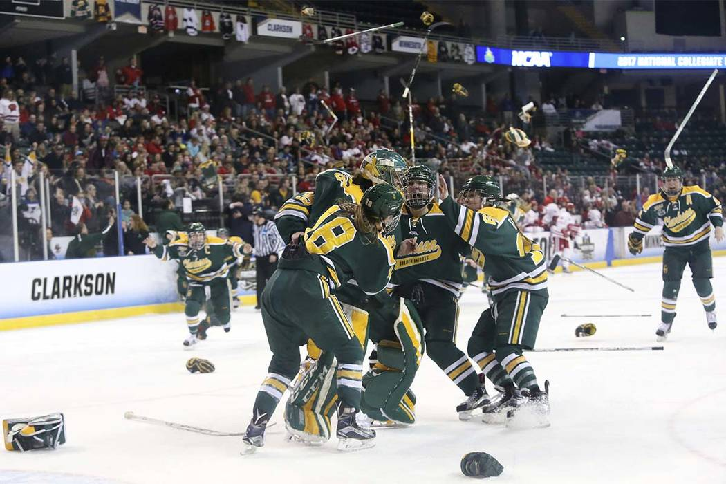 2a3acec7e8d Clarkson players celebrate after defeating Wisconsin 3-0 in the NCAA  Division I Women's Frozen