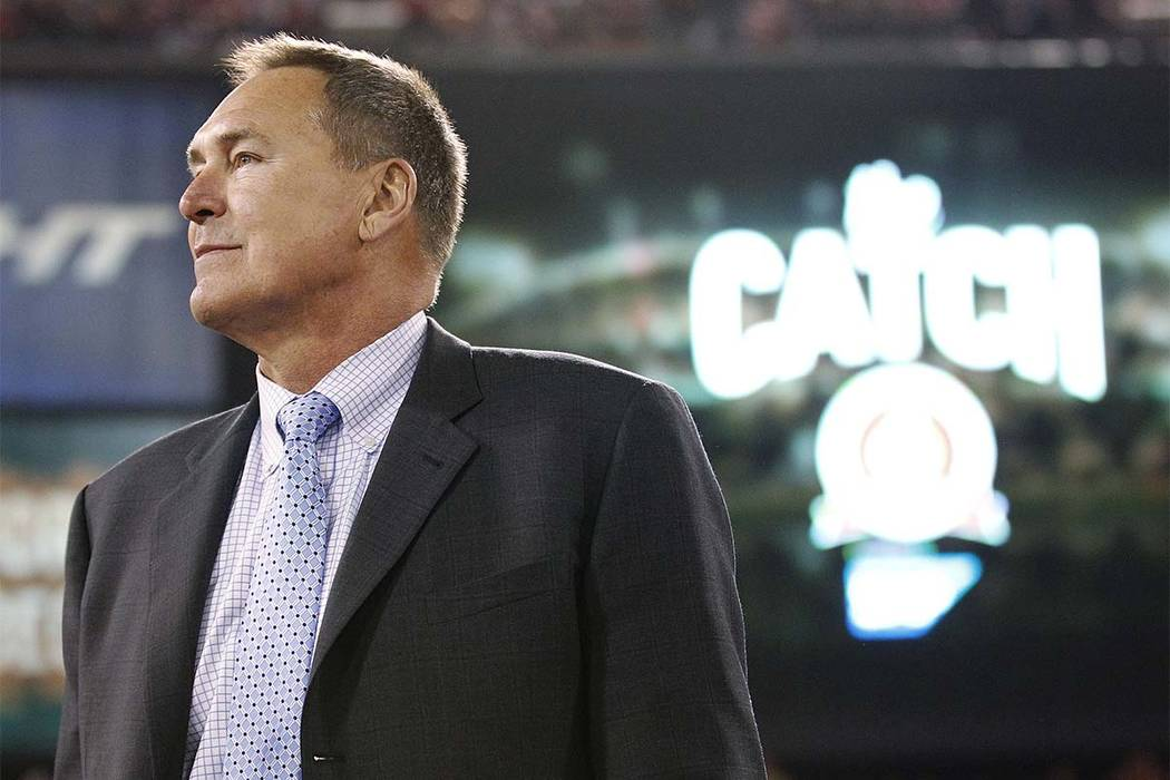 FILE - In this Dec. 23, 2013, file photo, former San Francisco 49ers wide receiver Dwight Clark is honored at halftime between the 49ers and the Atlanta Falcons in San Francisco. (Tony Avelar/AP)