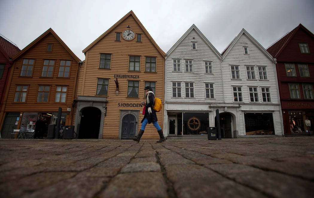FILE PHOTO -  A woman walks near Bryggen (the Wharf) near the marina in downtown Bergen, March 20, 2012. (Stoyan Nenov/Reuters)