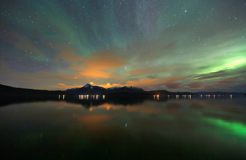 The Aurora Borealis is seen over the Bals-Fiord near the Norwegian village of Mestervik, north of the Arctic Circle. Norway is the world's happiest country. (Yannis Behrakis/Reuters)