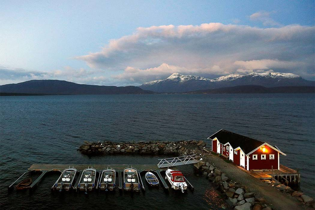 The view of the snow-capped mountains in Bals-Fiord, north of the Arctic Circle, near the village of Mestervik in northern Norway -- the happiest country in the world. (Yannis Behrakis/Reuters)