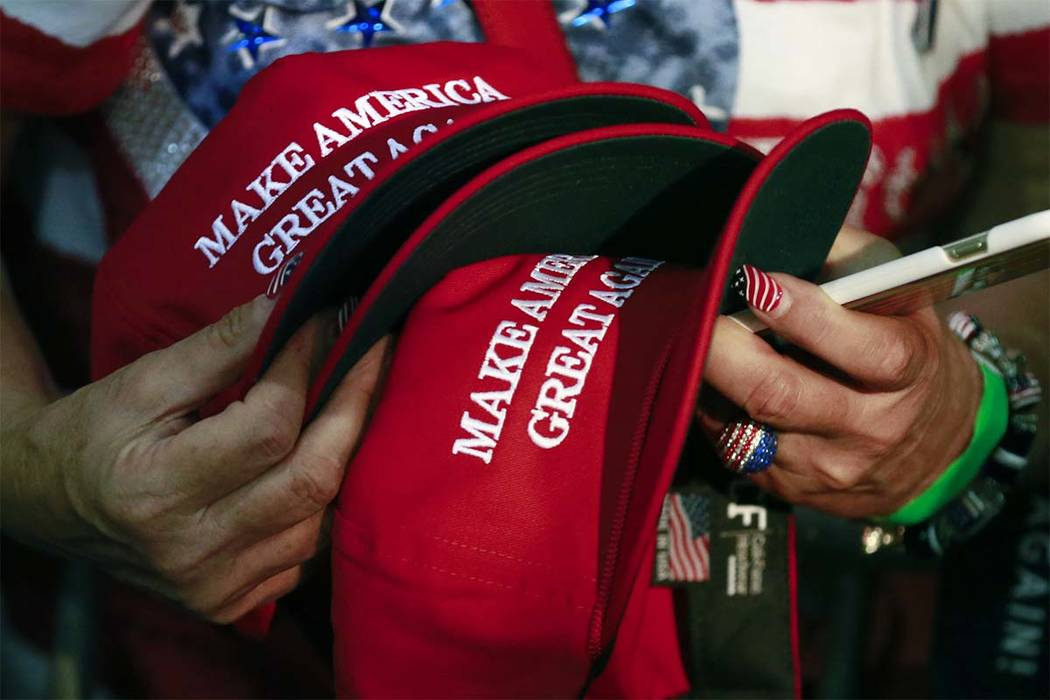 A Philadelphia man has sued a New York City bar claiming he was denied service for wearing a pro-Donald Trump hat. (Jae C. Hong/AP)