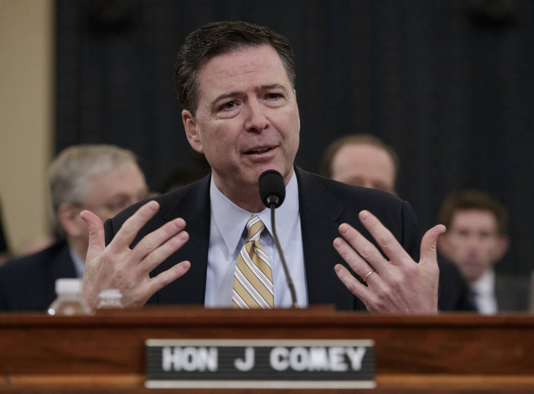 FBI Director James Comey testifies on Capitol Hill in Washington, Monday, March 20, 2017, before the House Intelligence Committee hearing on allegations of Russian interference in the 2016 U.S. pr ...