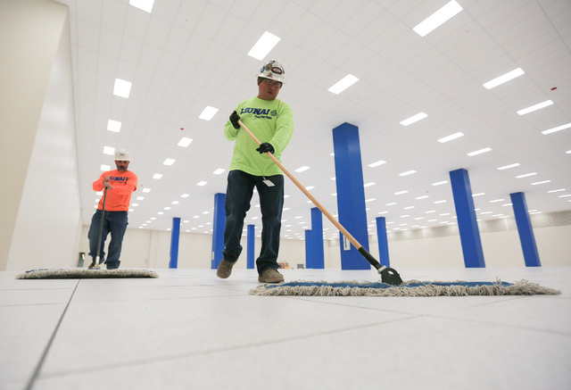 Jorge Sanchez, 41, right, and Marco Flores, 41, clean the floor of a server room expansion, built by Better Building Systems, at the ViaWest Lone Mountain Data Center on Friday, Feb. 24, 2017, in  ...