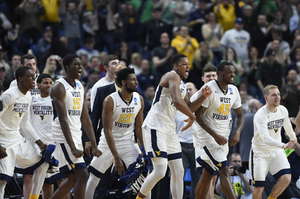 Mar 18, 2017; Buffalo, NY, USA; The West Virginia Mountaineers bench reacts in the second half against the Notre Dame Fighting Irish during the second round of the 2017 NCAA Tournament at KeyBank  ...
