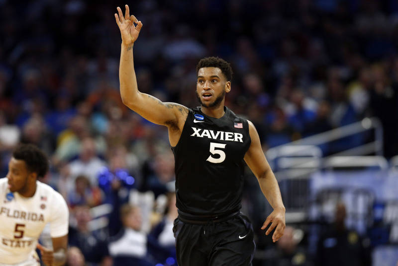 Mar 18, 2017; Orlando, FL, USA; Xavier Musketeers guard Trevon Bluiett (5) reacts after making a three point shot against the Florida State Seminoles during the second half in the second round of  ...