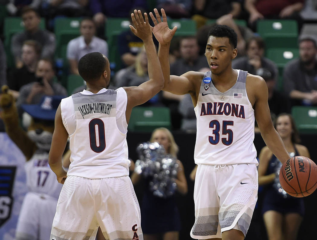 March 18, 2017; Salt Lake City, UT, USA; Arizona Wildcats guard Allonzo Trier (35) and guard Parker Jackson-Cartwright (0) react during the 69-60 victory against the Saint Mary's Gaels in the seco ...