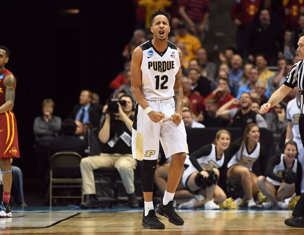 Mar 18, 2017; Milwaukee, WI, USA; Purdue Boilermakers forward Vince Edwards (12) celebrates during the second half of the game against the Iowa State Cyclones in the second round of the 2017 NCAA  ...