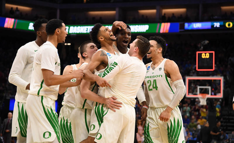 Mar 19, 2017; Sacramento, CA, USA; Oregon Ducks guard Tyler Dorsey (5) celebrates with teammates after the win against Rhode Island Rams during the second round of the 2017 NCAA Tournament at Gold ...