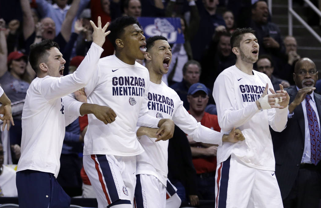 Gonzaga players celebrate on the bench during the second half of an NCAA Tournament college basketball regional semifinal game against West Virginia Thursday, March 23, 2017, in San Jose, Calif. ( ...