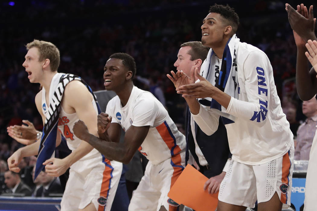 Florida players cheer on teammates in the first half against Wisconsin during an East Regional semifinal game of the NCAA men's college basketball tournament, Friday, March 24, 2017, in New York.  ...