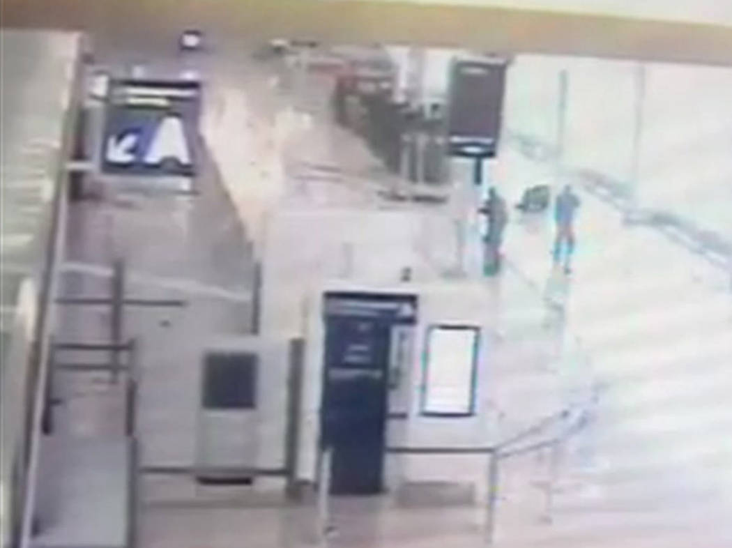 In this image taken from video of CCTV footage provided to AP on the condition that its source not be revealed, suspected Islamic extremist Ziyed Ben Belgacem remains on the ground, top left, afte ...