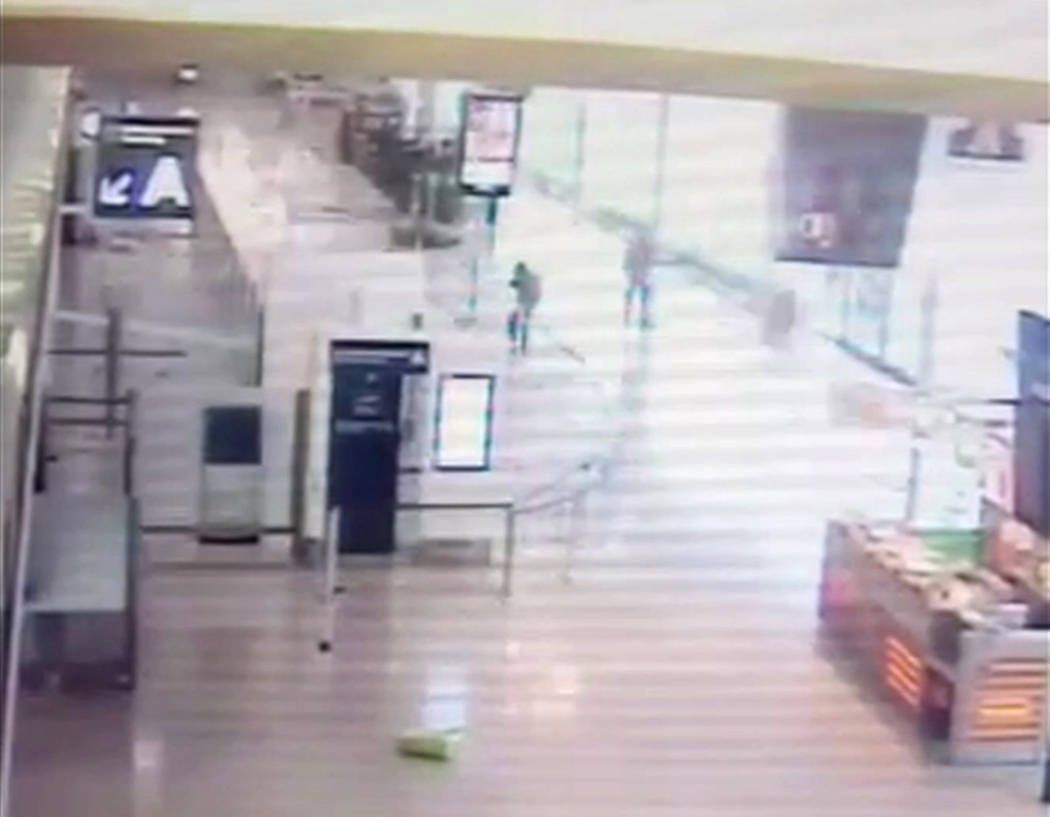 In this image taken from video of CCTV footage provided to AP on the condition that its source not be revealed, two soldiers take aim at suspected Islamic extremist Ziyed Ben Belgacem, top left, a ...