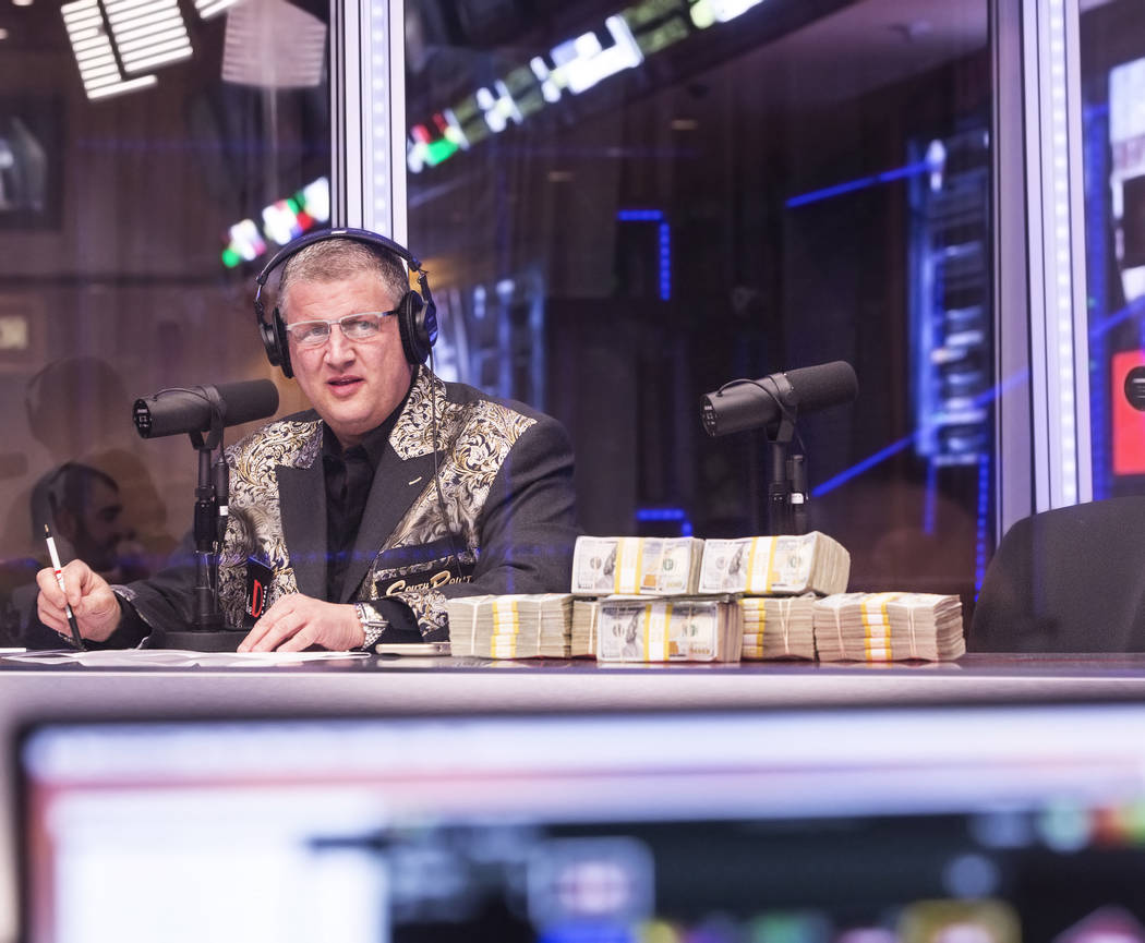 Derek Stevens, owner of the D Las Vegas hotel-casino, watches opening round lines come in during a live broadcast covering the NCCA Tournament on the Vegas Stats & Information Network on Sunda ...