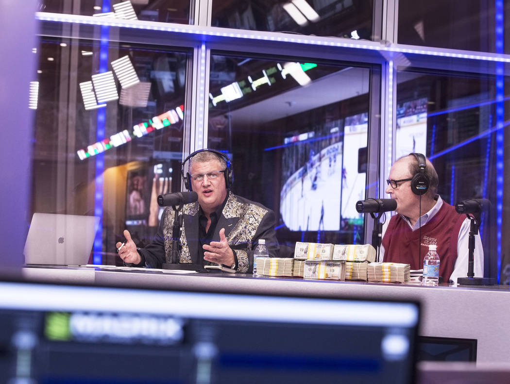 Derek Stevens, left, owner of the D Las Vegas hotel-casino, and handicapper Bruce Marshall discuss opening round lines during a live broadcast covering the NCCA Tournament on the Vegas Stats & ...