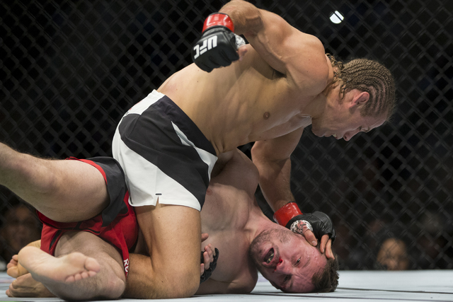Urijah Faber, top, battles Brad Pickett in the UFC Fight Night bantamweight bout at the Golden 1 Center on Saturday, Dec. 17, 2016, in Sacramento, Calif. Faber won by unanimous decision. Erik Verd ...
