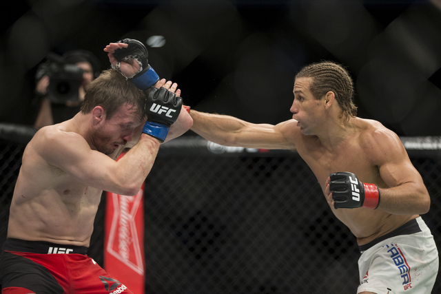 Urijah Faber, right, throws a punch against Brad Pickett in the UFC Fight Night bantamweight bout at the Golden 1 Center on Saturday, Dec. 17, 2016, in Sacramento, Calif. Faber won by unanimous de ...