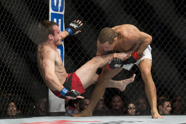 Urijah Faber, right, takes down Brad Pickett in the UFC Fight Night bantamweight bout at the Golden 1 Center on Saturday, Dec. 17, 2016, in Sacramento, Calif. Faber won by unanimous decision. Erik ...