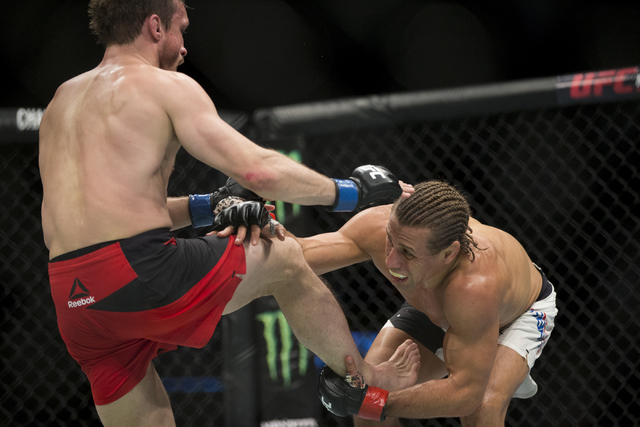 Brad Pickett, left, battles Urijah Faber in the UFC Fight Night bantamweight bout at the Golden 1 Center on Saturday, Dec. 17, 2016, in Sacramento, Calif. Faber won by unanimous decision. Erik Ver ...