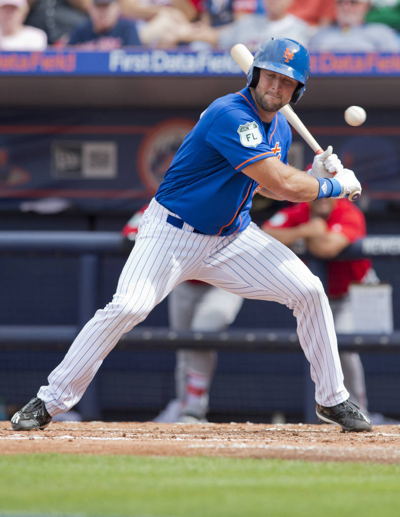 New York Mets designated hitter Tim Tebow lets a pitch go by during his second at-bat in the team's spring training baseball game against the Boston Red Sox on Wednesday, March 8, 2017, in Port St ...