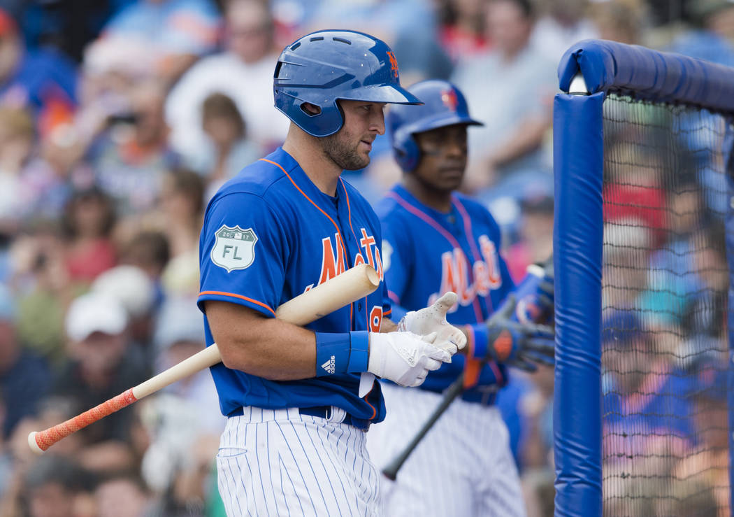 New York Mets designated hitter Tim Tebow walks back to the dugout during a spring training baseball game against the Boston Red Sox in the sixth inning on Wednesday, March 8, 2017, at First Data  ...