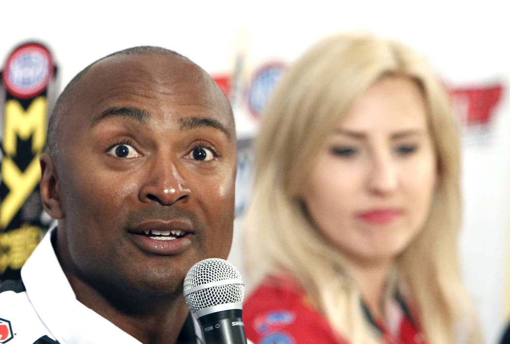 Antron Brown, driver of the Matco Tools Top Fuel dragster, and Courtney Force, driver of the Advance Auto Parts Chevy Camaro Funny Car,  during a press conference on Thursday, March 30, 2017, in L ...