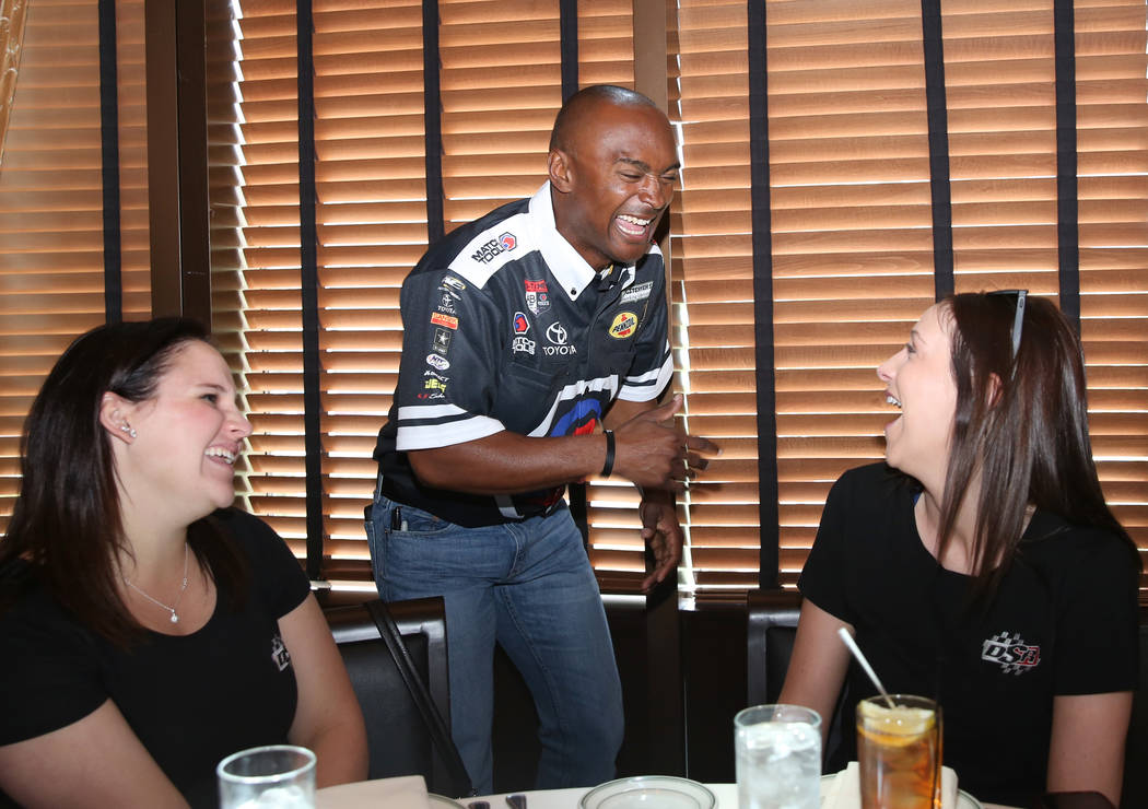 Antron Brown, center, driver of the Matco Tools Top Fuel dragster, chats with Allie Bland, left, and Leah Vaughn during a press conference on Thursday, March 30, 2017, in Las Vegas. (Bizuayehu Tes ...