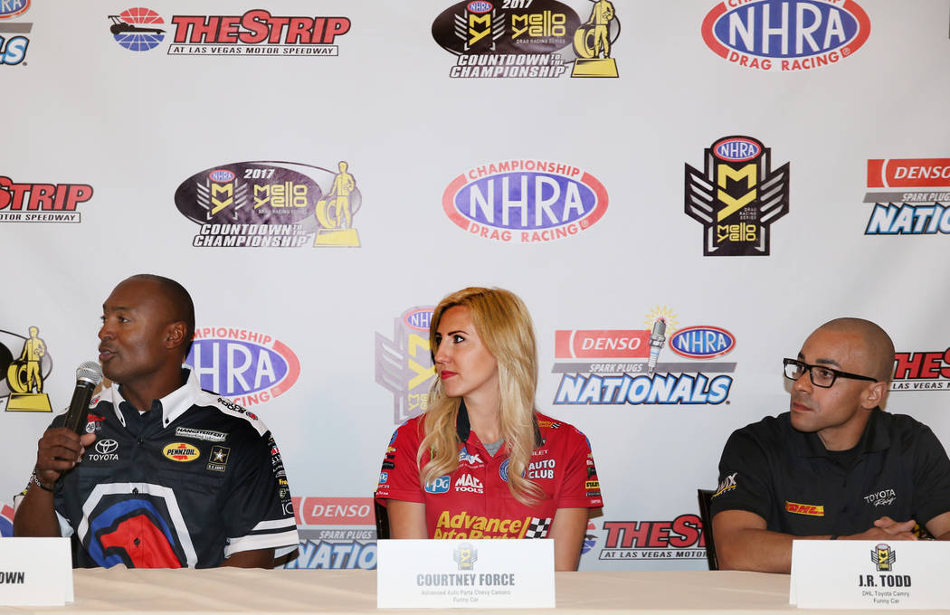 Antron Brown, left, driver of the Matco Tools Top Fuel dragster, Courtney Force of the Advance Auto Parts Chevy Camaro Funny Car, and J.R. Todd, right, of the DHL Toyota Camry Funny Car, during a  ...