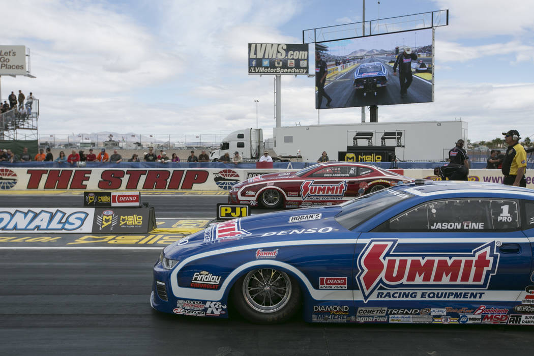 Pro Stock driver Greg Anderson, left, and Jason Line, right prepare to race during a National Hot Rod Association qualifying session at The Strip at Las Vegas Motor Speedway on Friday, March 31, 2 ...