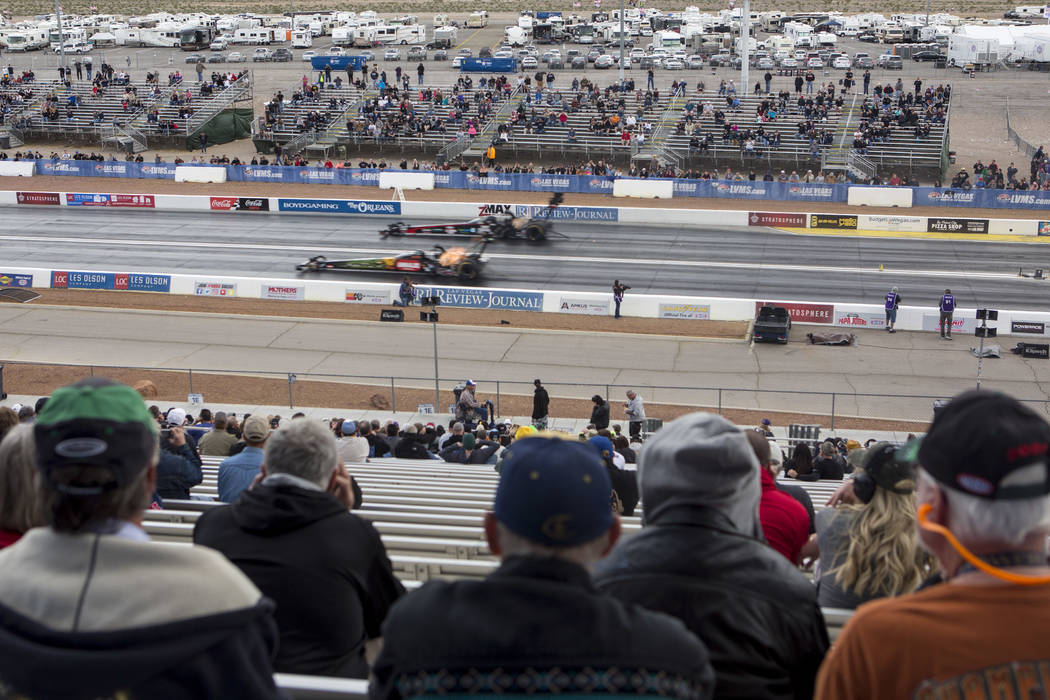Fans pass Courtney Force's pit crew during a National Hot Rod Association qualifying session at The Strip at Las Vegas Motor Speedway on Friday, March 31, 2017, in Las Vegas. (Bridget Bennett/Las  ...