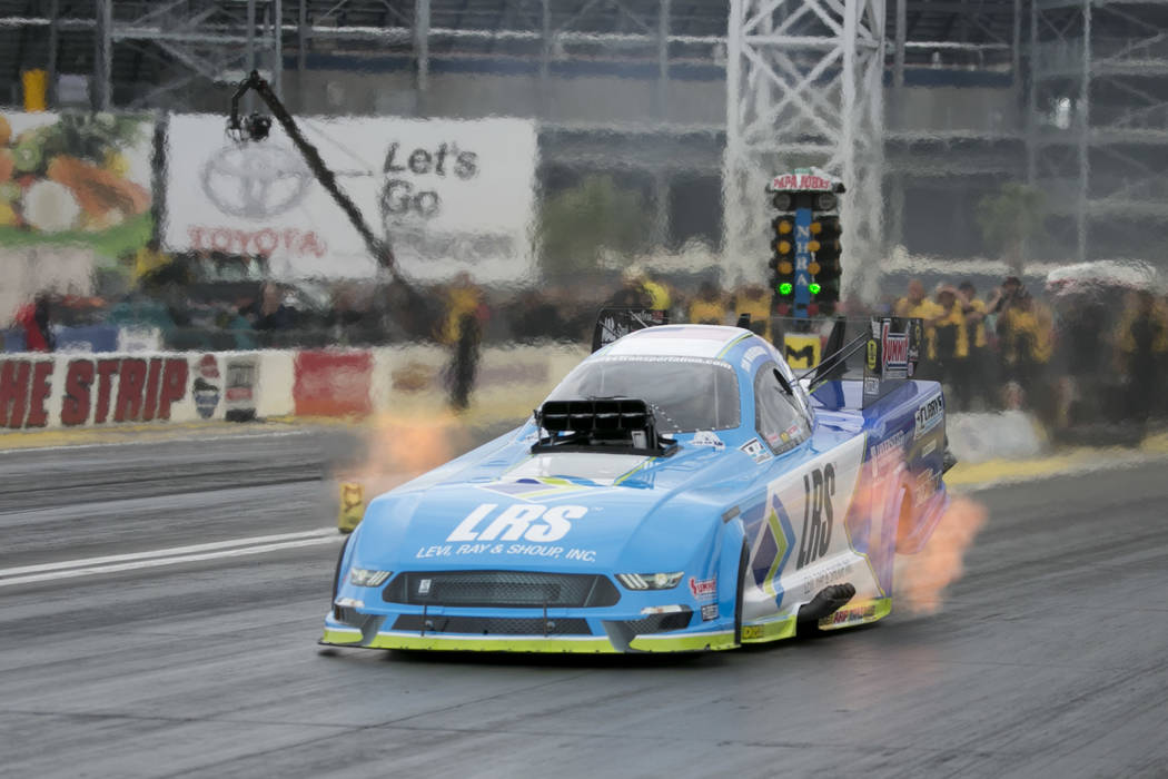 Funny Car driver Tim Wilkerson races during a National Hot Rod Association qualifying session at The Strip at Las Vegas Motor Speedway on Friday, March 31, 2017, in Las Vegas. (Bridget Bennett/Las ...