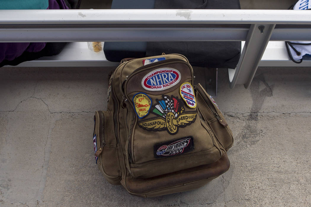 A backpack with various racing patches lays on the ground during National Hot Rod Association qualifying sessions at The Strip at Las Vegas Motor Speedway on Friday, March 31, 2017, in Las Vegas.  ...