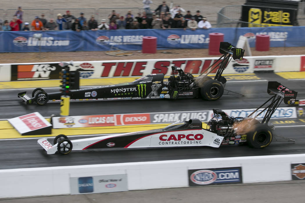 Top Fuel drivers Brittany Force, top, and Billy Torrence race during the first National Hot Rod Association qualifying session at The Strip at Las Vegas Motor Speedway on Friday, March 31, 2017, i ...
