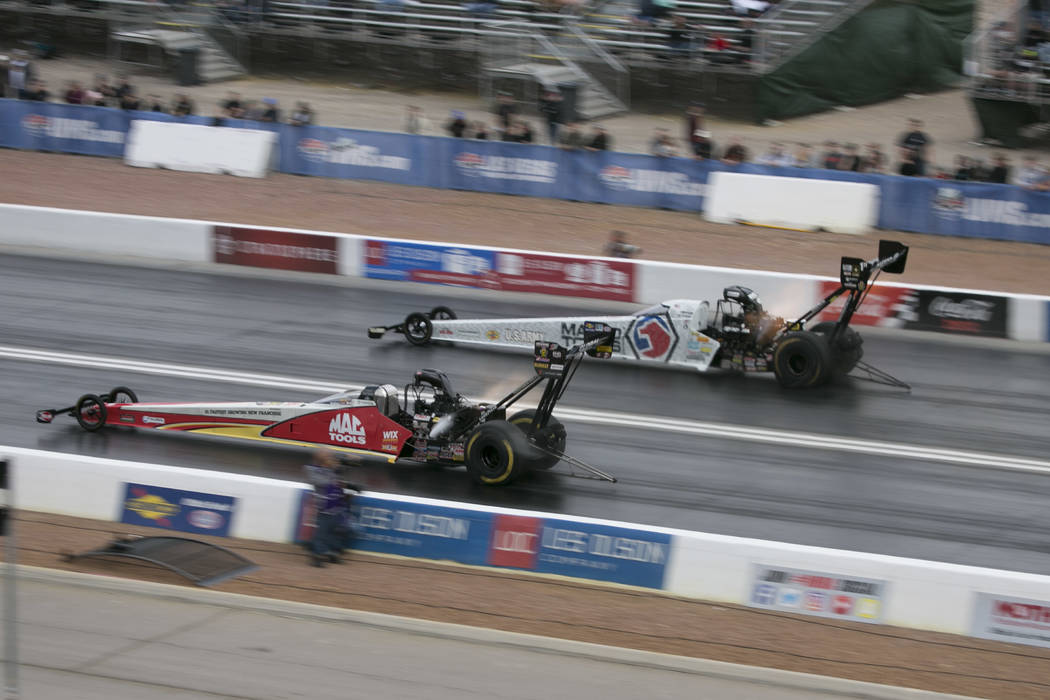 Top Fuel drivers Doug Kalitta, left, and Antron Brown, right, race during a National Hot Rod Association qualifying session at The Strip at Las Vegas Motor Speedway on Friday, March 31, 2017, in L ...